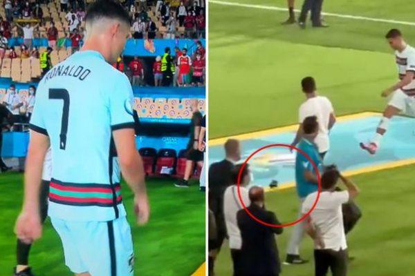 Cristiano Ronaldo kicks the captain's armband